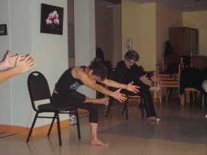 Annette leading chair yoga group